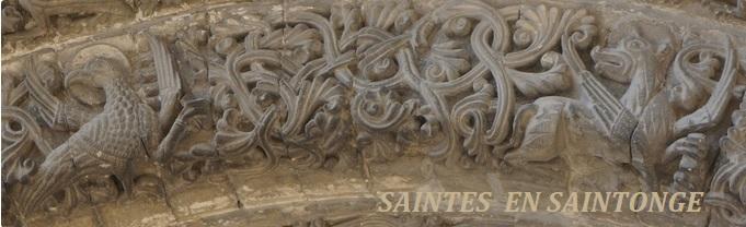 En deuxième voussure l'aigle de St Jean et le lion de St Marc encadrent l'agneau cruciphore…